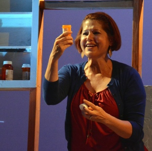 """Lisa-Marie Newton as Diana struggles with her feelings about taking pills for her bipolar disorder in """"Next To Normal"""". Photo Credit: Jay Yamada."""