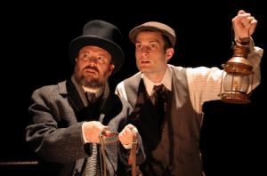 "C. Conrad Cady (L) and Mark Frazier (R) in Douglas Morrison Theater's haunting production of ""The woman In Black."" Photo Credit: Douglas Morisson Theatre."