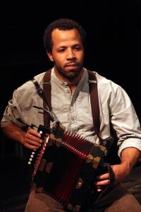 The accordian-playing Cecil (Tyee Tilghman). Photo Credit: Jennifer Reiley