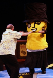 Mr. Peanut (a disguised AJ Davenport) attacks the cockney Lithuanian (Stefin Collins).