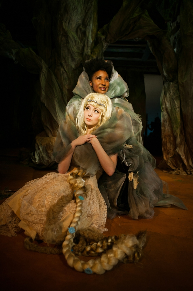 """Rapunzel (Noelani Neal) is comforted by her """"mother"""" the Witch (Safiya Fredericks). Photo Credit: Jessica Palopoli."""