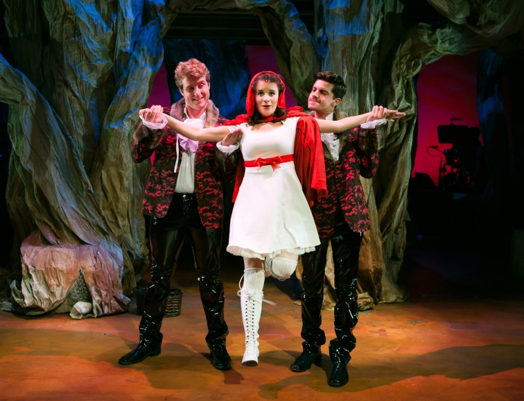 Wolves (Ryan McCrary and Jeffrey Brian Adams) meet Little Red Ridinghood (Corinne Proctor) in the woods. Photo Credit: Jessica Palopoli.