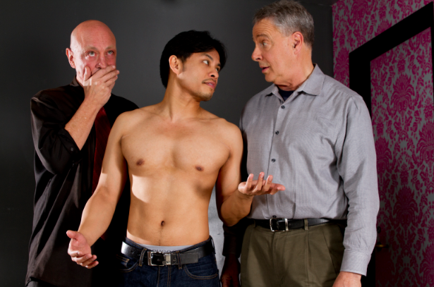 "(from l to r) Michael DeMartini as Neil, the playwright, Justin Lucas as the actor Tim playing the role of prostitute Stuart, and Donald Currie as the actor Fitz, playing the role of poet W. H. Auden in Allan Bennett's ""The Habit of Art"" at Theatre Rhino. Photo Credit: Kent Taylor."