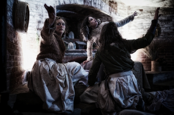 The Three Weird Sisters in We Players production of Macbeth staged in Fort Point, under the Golden Gate Bridge. Photo Credit: We Players.