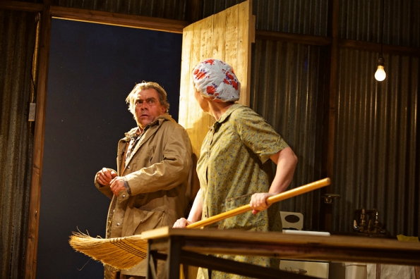 Breda (Anne Darragh) chases Patsy the Fishmonger off with a broom. Photo Credit: Pak Han.
