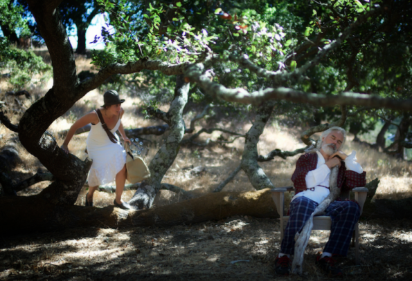 """Ava Roy and John Hadden in """"King Fool"""", performing on a hillside in San Anselmo, one of several locations for this production. Photo Credit: We Players."""