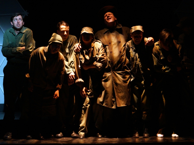 "American prisoners of war are transported to Dresden by boxcar in ""Slaughterhouse Five"" at Custom Made Theatre. Photo Credit: Jay Yamada."