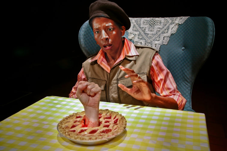 "Velina Brown, as Diane, the radio reporter, has a close encounter with revolutionary baked goods in ""Recipe"" at Central Works. Photo Credit: Jim Norrena."
