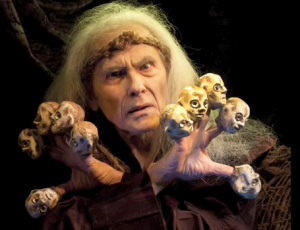 Conrad Bishop as Lear creates a roomful of courtiers using finger puppets.