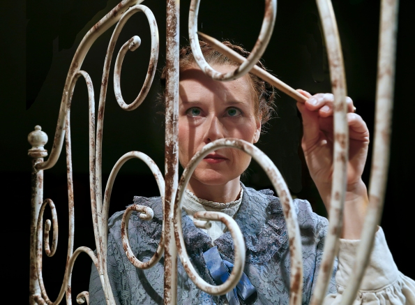 Elena Wright, as Jane, is driven mad by her confinement. Photo Credit: Central Works.