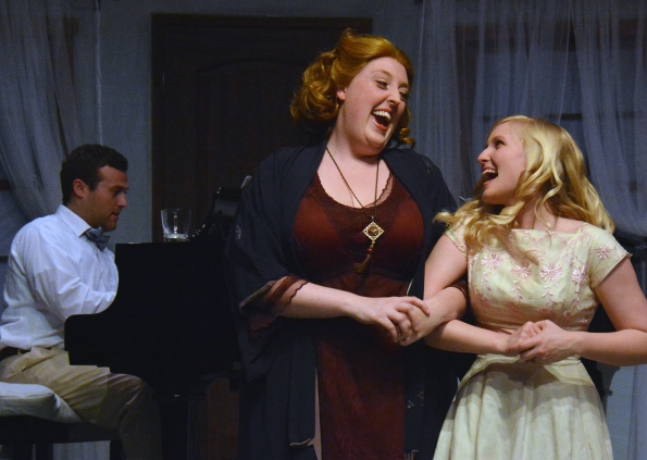 """Big"" Edie (Heather Orth) and ""Little"" Edie (Juliana Lustenader), happy before their decline, accompanied at the piano by George Gould Strong (David Aaron Brown). Photo Credit: Jay Yamada."