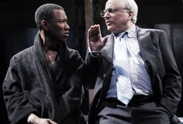 "A teenaged Frederick Douglass (Giovanni Adams)  is not sure he wants to buy what Donald Rumsfeld (David Sinaiko) is selling in Cutting Ball's world premiere production of Andrew Saito's ""Mount Misery."" Photo Credit: Cutting Ball Theater."