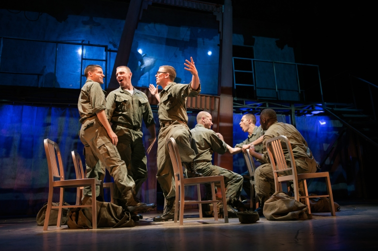 Marines (Jeffrey Brian Adams, Brandon Dahlquist, Andrew Humann, Andy Rotchadl, Nikita Burshteyn, and Aejay Mitchell) get ready for their last night on the town. Photo Credit: Jessica Palopoli.