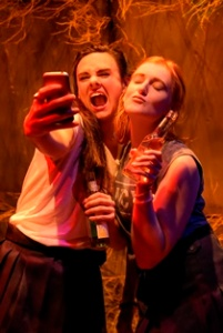 "From L to R:: Sam (Jessica Lynn Carroll) and Kelly (Chelsea Looy) are confused adolescents in the American premiere of Lachlan Phillpott's ""TRruck Stop"" at Crowded Fire Theater. Photo Credit: mellopix.com."