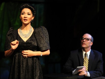 """Imelda (Beverly Sotelo) grants an interview to Bob Stone (Lawrence Radecker). (photo Jennifer Reiley) in Magic Theater's production of """"Dogeaters"""" by Hagedorn."""