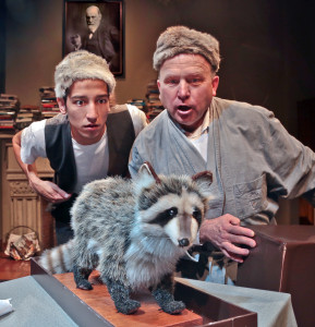 "Ed Norton and Ralph Kramden (Caleb Cabrera and Bob Greene), unveil the mascot of their beloved Raccoon Lodge during a drug-induced dream journey to ""The Honeymooners"" in Central Works production of ""Totem & Taboo"" by David Weisberg. Photo Credit: J. Norrena."