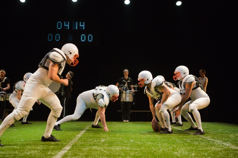"In Andrew Hinderaker's ""Colossal,"" actors in full athletic gear recreate an actual four-quarter football game onstage."