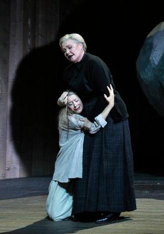 Malin Byström as Jenůfa (Malin Byström) clings to her mother, Kostelnička Buryjovka (Karita Mttila). Photo Credit: Cory Weaver.