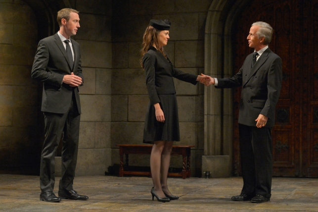 "Prince William (Christopher McLinden) and Kate (Allison Jean White) greet King Charles III (Robert Joy) after the funeral of Queen Elizabeth in Mike Barlett's ""King Charles III"". Photo credit: Kevin Berne"