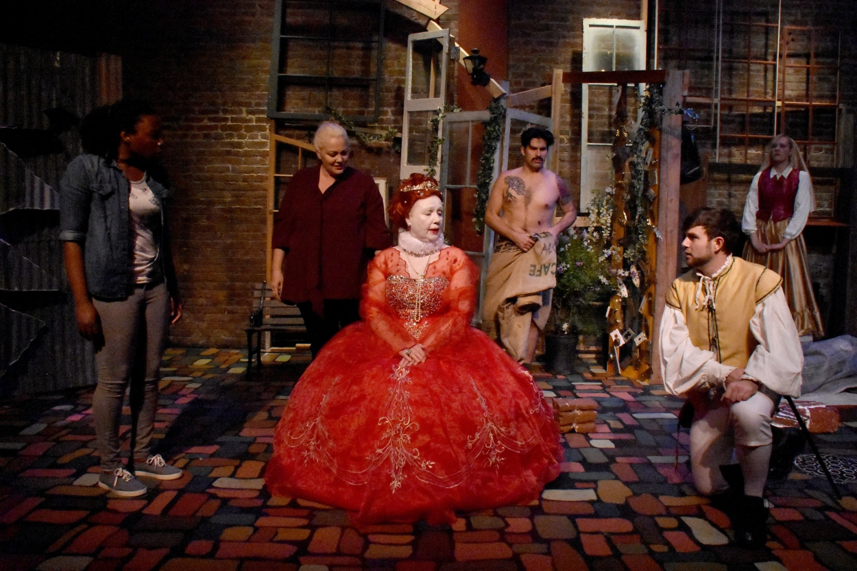 """Queen Elizabeth (Christina Augello) is a time travelling """"goddess in the machine"""" who startles the denizens of Liverpool's Paradise Street one peculiar Christmas Eve in Clive Barker's masque-like play."""