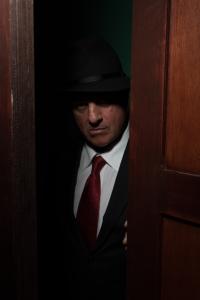 """Freddie Lawson as Vinnie welcomes customers to """"The Speakeasy"""". Photo Credit: Peter Liu."""